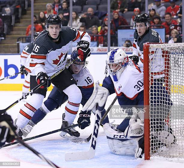 Taylor Raddysh of Team Canada looks for a pass to put at the net against Adam Huska of Team Slovakia during a preliminary game in the 2017 IIHF World...