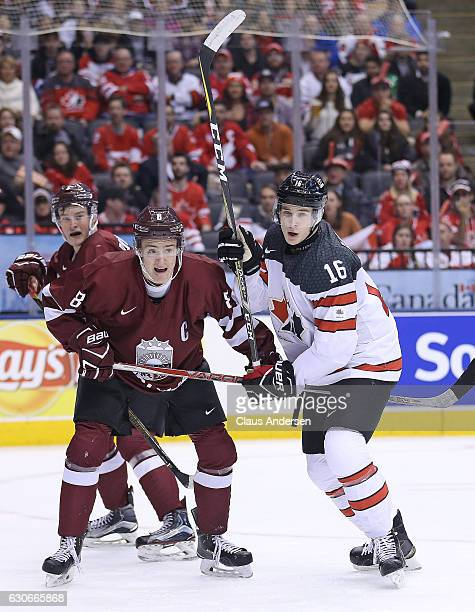 Taylor Raddysh of Team Canada skates against Kristaps Zile of Team Latvia during a preliminary game in the 2017 IIHF World Junior Hockey...