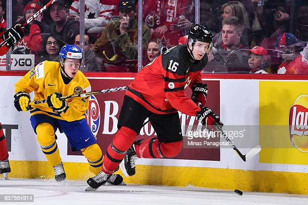 Taylor Raddysh of Team Canada skates the puck against Tim Soderlund of Team Sweden during the 2017 IIHF World Junior Championship semifinal game at...