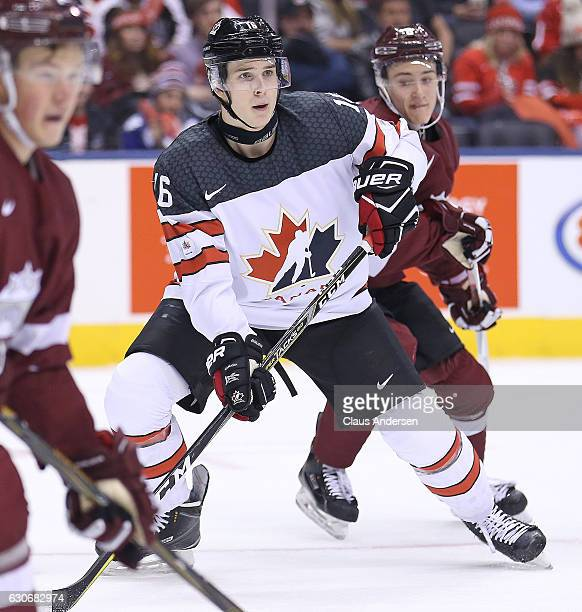 Taylor Raddysh of Team Canada waits to redirect a shot against Team Latvia during a preliminary game in the 2017 IIHF World Junior Hockey...
