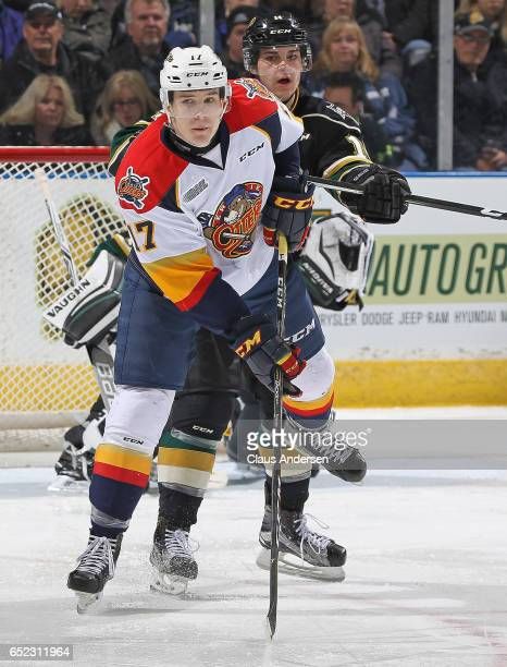 Taylor Raddysh of the Erie Otters battles against Brandon Crawley of the London Knights during an OHL game at Budweiser Gardens on March 10 2017 in...