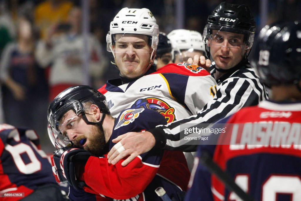 Taylor Raddysh #17 of the Erie Otters battles in front of the net against forward Aaron Luchuk #91 of the Windsor Spitfires on May 28, 2017 during the championship game of the Mastercard Memorial Cup at the WFCU Centre in Windsor, Ontario, Canada.