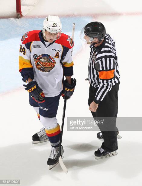 Taylor Raddysh of the Erie Otters voices his thoughts to referee during a timeout against the London Knights in Game Six of the OHL Western...