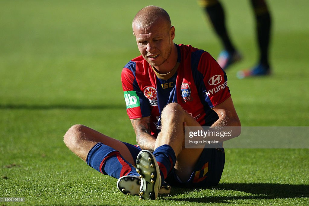 Taylor Regan of the Jets goes down with cramp at the end of the game during the round 18 A-League match between the Wellington Phoenix and the Newcastle Jets at Westpac Stadium on January 27, 2013 in Wellington, New Zealand.