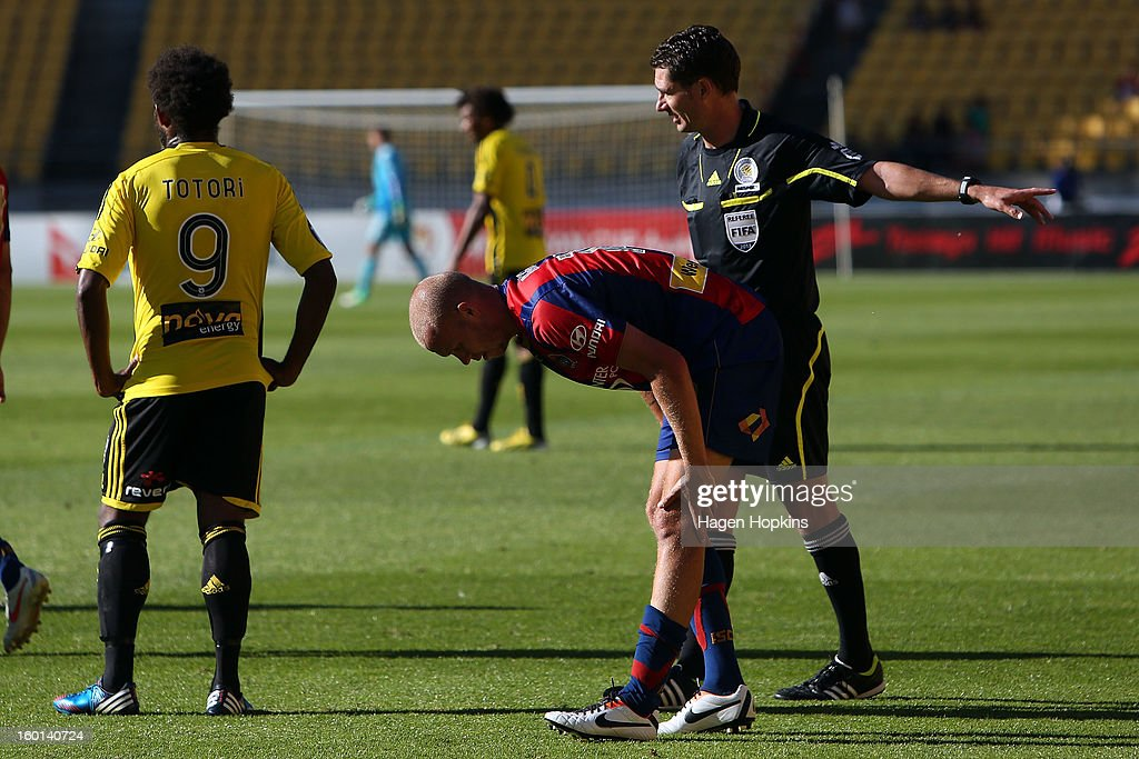 Taylor Regan of the Jets tends to his cramp at the end of the game during the round 18 A-League match between the Wellington Phoenix and the Newcastle Jets at Westpac Stadium on January 27, 2013 in Wellington, New Zealand.