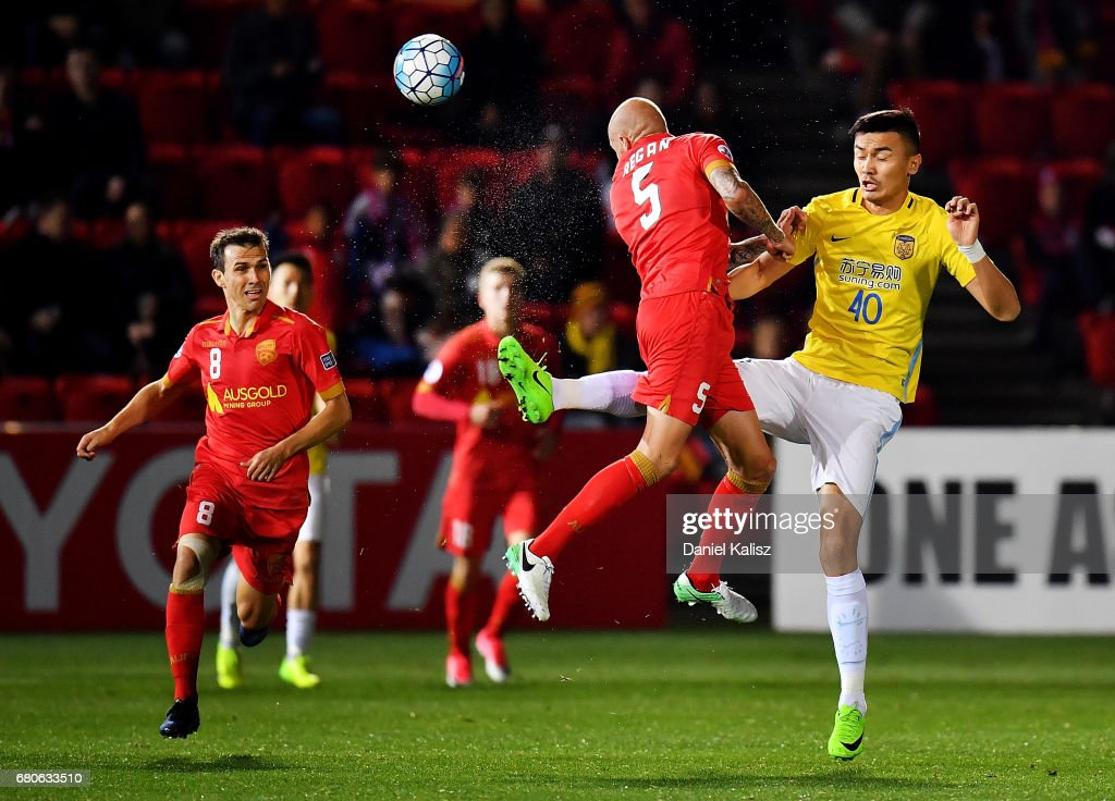 Taylor Regan of United and Ge Wei of Jiangsu FC compete for the ball during the AFC Champions League match between Adelaide United and Jiangsu Sainty at Hindmarsh Stadium on May 9, 2017 in Adelaide, Australia.