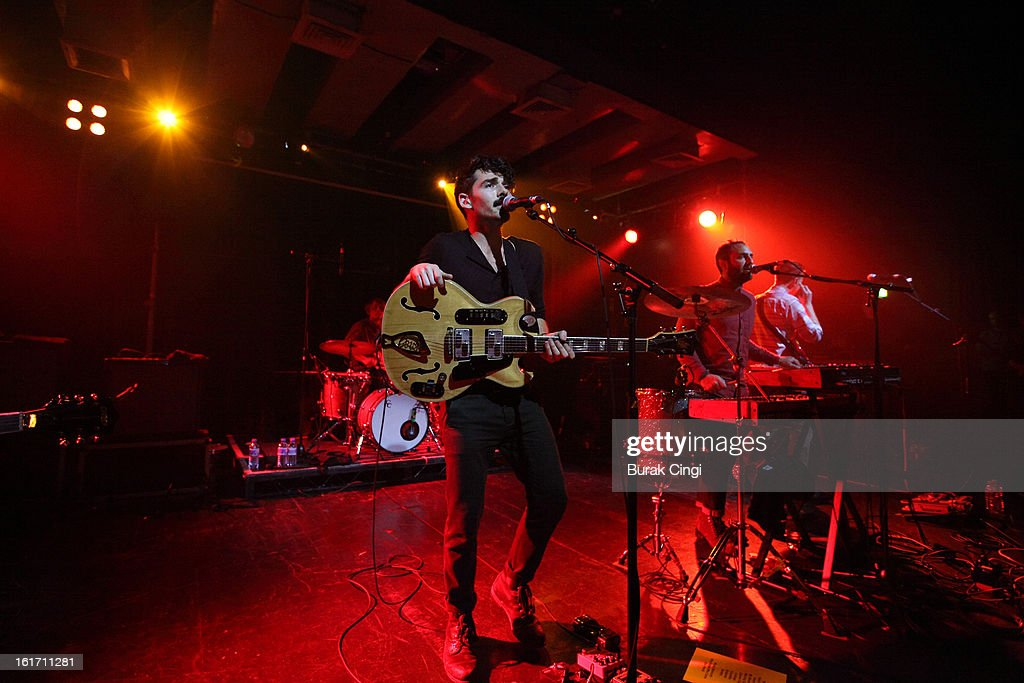 Taylor Rice and Kelcey Ayer of Local Natives perform on stage at Scala on February 14, 2013 in London, England.