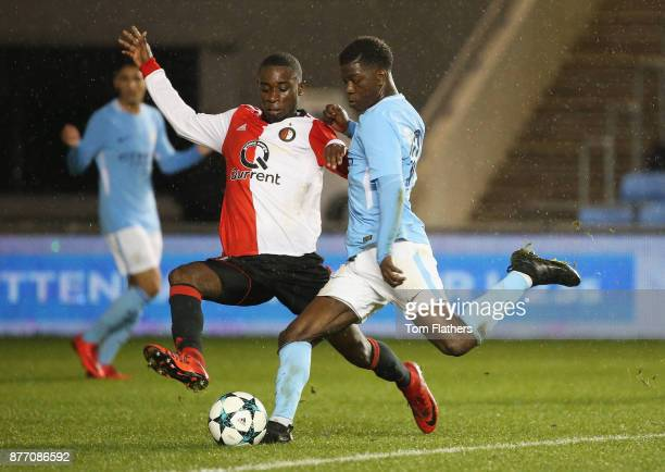 Taylor Richards of Manchester City is challenged by Lutsharel Geertruida of Feyenoord during the UEFA Youth League Group F match between Manchester...