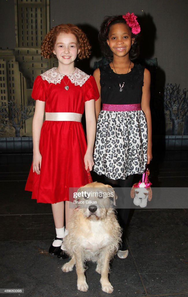 Taylor Richardson as 'Annie' and Quvenzhané Wallis pose with 'Sandy' backstage at 'Annie' on Broadway at The Palace Theater on December 22 2013 in...