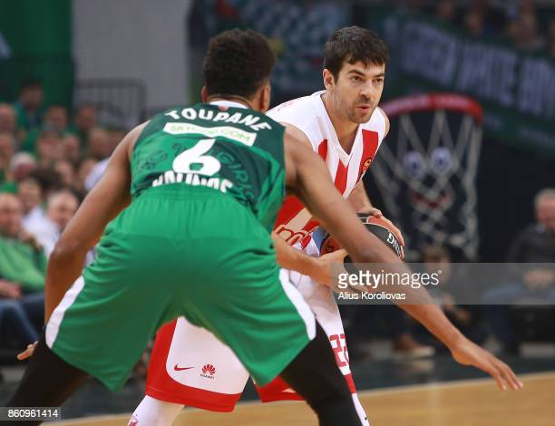 Taylor Rochestie #22 of Crvena Zvezda mts Belgrade competes with Axel Toupane #6 of Zalgiris Kaunas in action during the 2017/2018 Turkish Airlines...