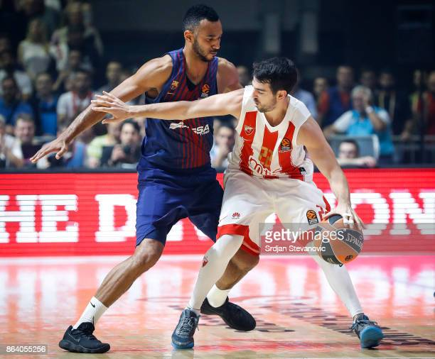 Taylor Rochestie of Crvena Zvezda in action against Adam Hanga of Barcelona during the 2017/2018 Turkish Airlines EuroLeague Regular Season game...