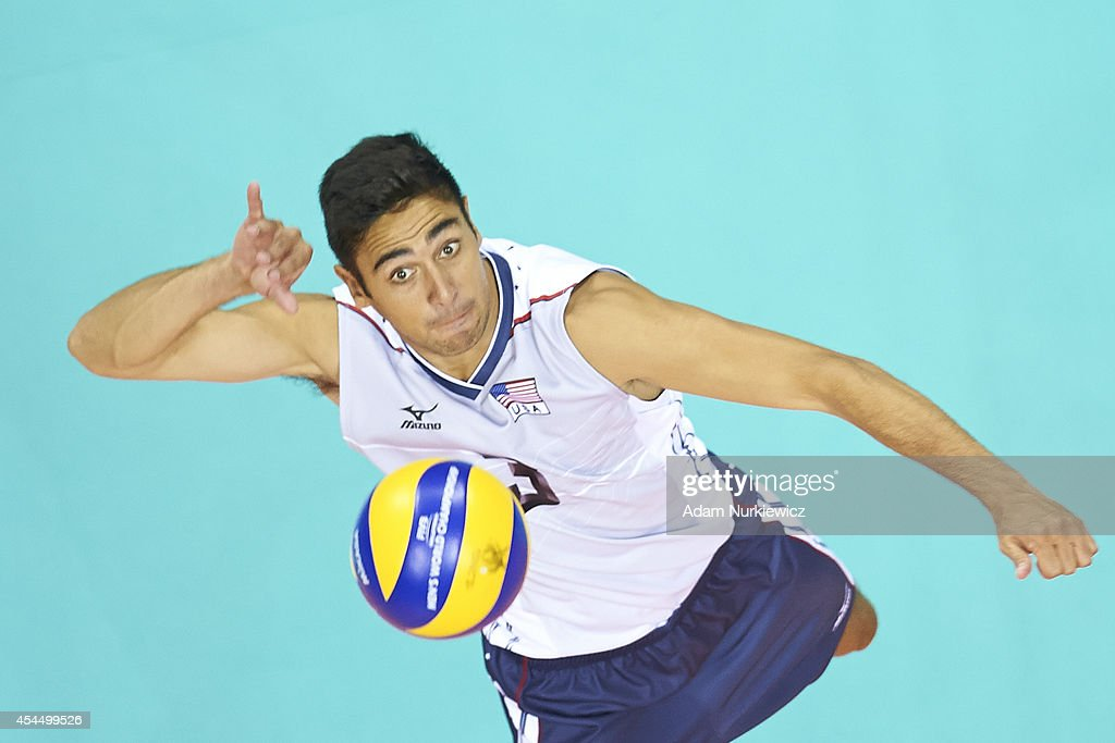 Taylor Sander of USA spikes the ball during the FIVB World Championships match between USA and Iran at Cracow Arena on September 2, 2014 in Cracow, Poland.
