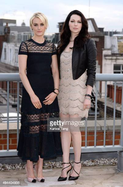 Taylor Schilling and Laura Prepon attend a photocall to launch season 2 of the Netflix exclusive series 'Orange Is The New Black' at Soho Hotel on...