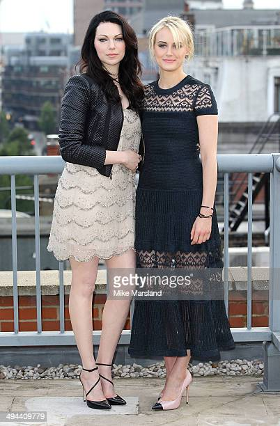 Taylor Schilling and Laura Prepon attend a photocall to launch season 2 of Netflix exclusive series 'Orange Is The New Black' on May 29 2014 in...