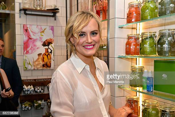 Taylor Schilling celebrates unveiling of Origins newly redesigned Harvard Square store on May 18 2016 in Boston Massachusetts