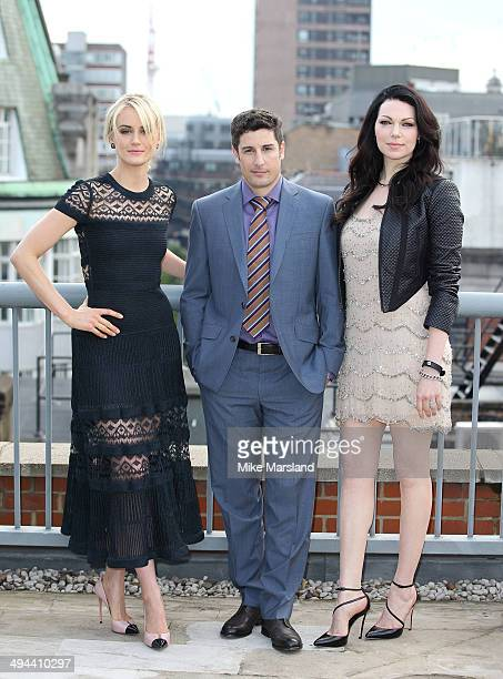 Taylor Schilling Jason Biggs and Laura Prepon attend a photocall to launch season 2 of Netflix exclusive series 'Orange Is The New Black' on May 29...