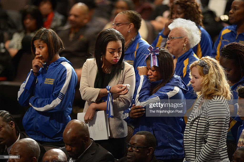Taylor Singleton, 14, left to right, Terkia White, 16, Monique Agbro, 15, and Kara Hibler, 15, mourn at a memorial service for Darrell Price Jr. and his daughters, Patrice Price, Tania Price, and Daijah Price at First Baptist Church of Glenarden on Monday March 04, 2013 in Upper Marlboro, MD. The four died as a result of a house fire last month.