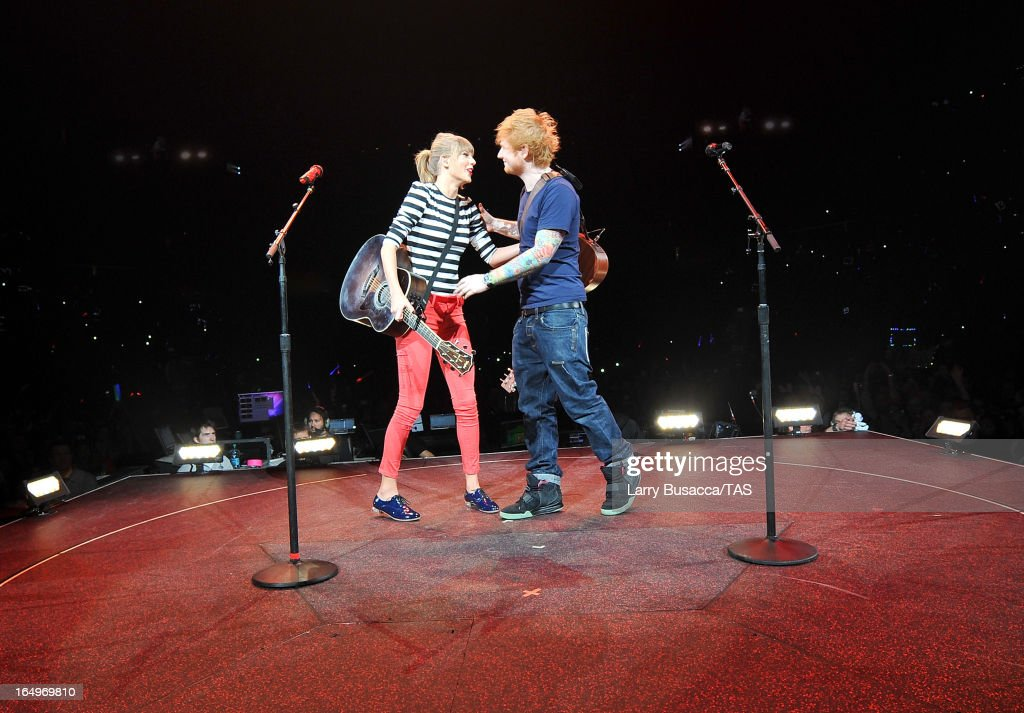 Taylor Swift and Ed Sheeran perform onstage at the Prudential Center on March 29, 2013 in Newark, New Jersey. Seven-time GRAMMY winner Taylor Swift plays 3 sold-out NY area shows at the Prudential Center this week on The RED Tour. Taylor plays electric guitar, banjo, piano and acoustic guitar and changes costumes 10 times over the course of the evening. The North American portion of The RED Tour will play 66 shows (including 13 stadium stops) in 47 cities in 29 states and 3 provinces spanning 6 months in 2013.