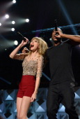 Taylor Swift and Hip Hop artist BOB perform onstage during Z100's Jingle Ball 2012 presented by Aeropostale at Madison Square Garden on December 7...