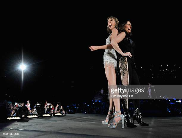 Taylor Swift and Idina Menzel perform on Taylor Swift's 'The 1989 World Tour' at Raymond James Stadium on October 31 2015 in Tampa Florida