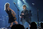 Taylor Swift and Johnny Rzeznik of the Goo Goo Dolls perform during the 'Speak Now World Tour' at Madison Square Garden on November 21 2011 in New...