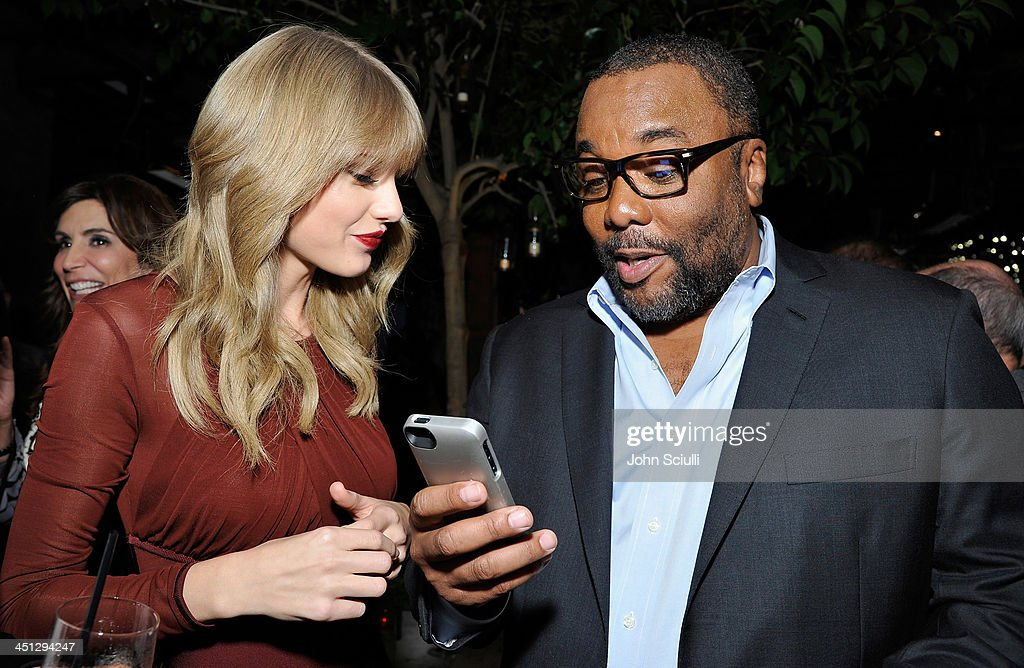 <a gi-track='captionPersonalityLinkClicked' href=/galleries/search?phrase=Taylor+Swift&family=editorial&specificpeople=619504 ng-click='$event.stopPropagation()'>Taylor Swift</a> and <a gi-track='captionPersonalityLinkClicked' href=/galleries/search?phrase=Lee+Daniels&family=editorial&specificpeople=209078 ng-click='$event.stopPropagation()'>Lee Daniels</a> attend the Weinstein Company's holiday party at RivaBella on November 21, 2013 in West Hollywood, California.