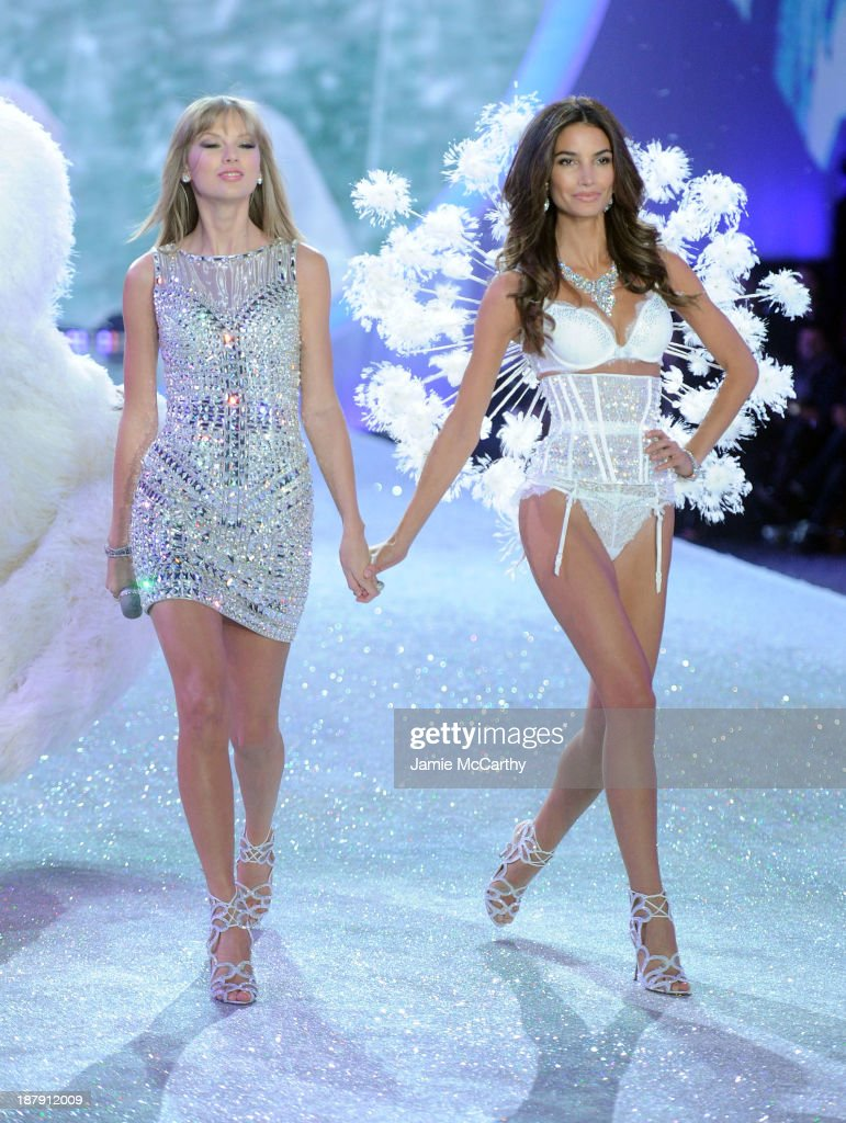 Taylor Swift and model Lily Aldridge walk the runway at the 2013 Victoria's Secret Fashion Show at Lexington Avenue Armory on November 13, 2013 in New York City.