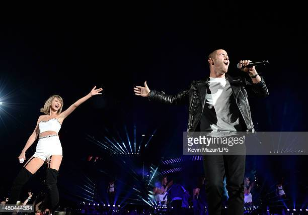 Taylor Swift and Nick Jonas perform onstage during The 1989 World Tour Live at MetLife Stadium on July 11 2015 in East Rutherford New Jersey