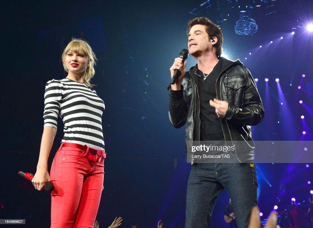 <a gi-track='captionPersonalityLinkClicked' href=/galleries/search?phrase=Taylor+Swift&family=editorial&specificpeople=619504 ng-click='$event.stopPropagation()'>Taylor Swift</a> and Pat Monahan perform onstage at the Prudential Center on March 29, 2013 in Newark, New Jersey. Seven-time GRAMMY winner <a gi-track='captionPersonalityLinkClicked' href=/galleries/search?phrase=Taylor+Swift&family=editorial&specificpeople=619504 ng-click='$event.stopPropagation()'>Taylor Swift</a> plays 3 sold-out NY area shows at the Prudential Center this week on The RED Tour. Taylor plays electric guitar, banjo, piano and acoustic guitar and changes costumes 10 times over the course of the evening. The North American portion of The RED Tour will play 66 shows (including 13 stadium stops) in 47 cities in 29 states and 3 provinces spanning 6 months in 2013.