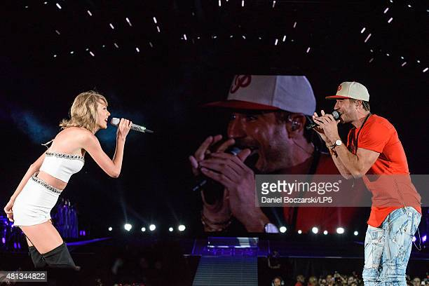 Taylor Swift and Sam Hunt perform during The 1989 Tour at Soldier Field on July 19 2015 in Chicago Illinois