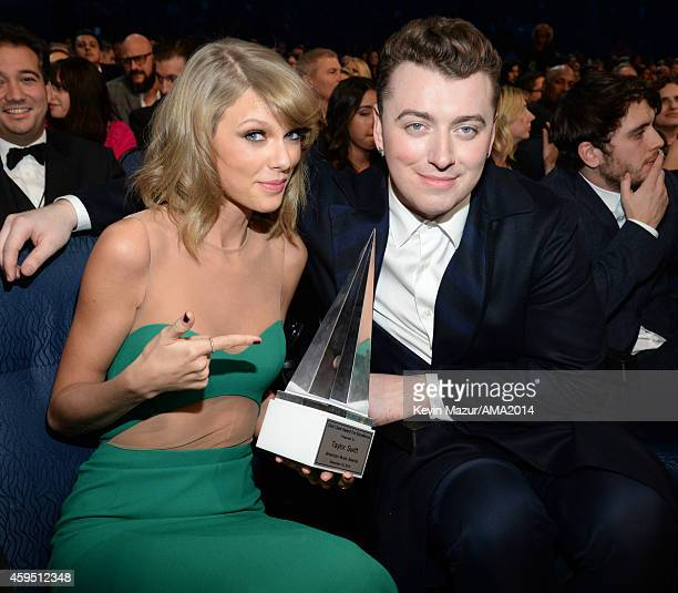 Taylor Swift and Sam Smith attend the 2014 American Music Awards at Nokia Theatre LA Live on November 23 2014 in Los Angeles California