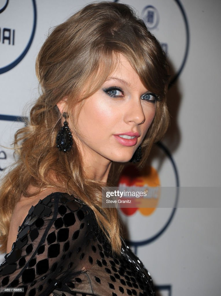 <a gi-track='captionPersonalityLinkClicked' href=/galleries/search?phrase=Taylor+Swift&family=editorial&specificpeople=619504 ng-click='$event.stopPropagation()'>Taylor Swift</a> arrives at the Clive Davis And The Recording Academy Annual Pre-GRAMMY Gala at The Beverly Hilton Hotel on January 25, 2014 in Beverly Hills, California.