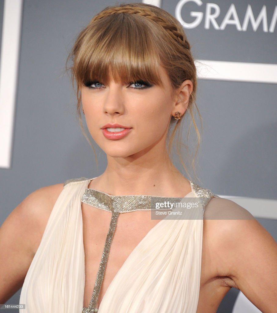 <a gi-track='captionPersonalityLinkClicked' href=/galleries/search?phrase=Taylor+Swift&family=editorial&specificpeople=619504 ng-click='$event.stopPropagation()'>Taylor Swift</a> arrives at the The 55th Annual GRAMMY Awards on February 10, 2013 in Los Angeles, California.