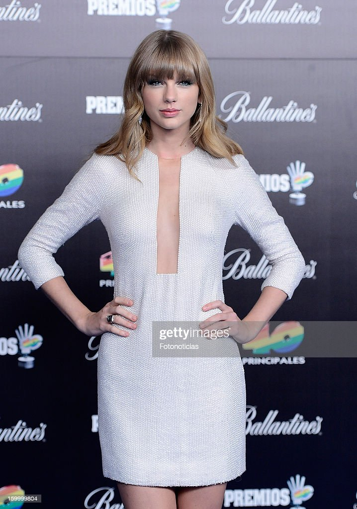 <a gi-track='captionPersonalityLinkClicked' href=/galleries/search?phrase=Taylor+Swift&family=editorial&specificpeople=619504 ng-click='$event.stopPropagation()'>Taylor Swift</a> arrives to '40 Principales Awards' 2012 at the Palacio de Deportes on January 24, 2013 in Madrid, Spain.