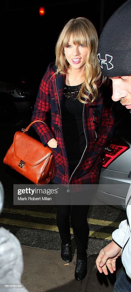 <a gi-track='captionPersonalityLinkClicked' href=/galleries/search?phrase=Taylor+Swift&family=editorial&specificpeople=619504 ng-click='$event.stopPropagation()'>Taylor Swift</a> at the Groucho club on February 21, 2013 in London, England.