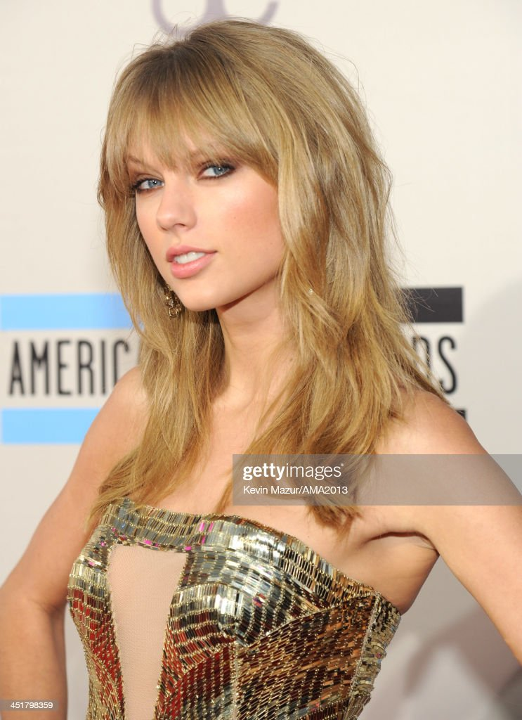 <a gi-track='captionPersonalityLinkClicked' href=/galleries/search?phrase=Taylor+Swift&family=editorial&specificpeople=619504 ng-click='$event.stopPropagation()'>Taylor Swift</a> attends the 2013 American Music Awards at Nokia Theatre L.A. Live on November 24, 2013 in Los Angeles, California.