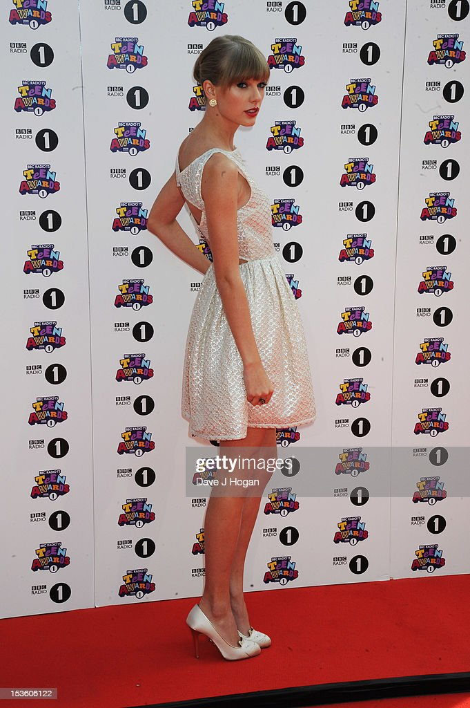 <a gi-track='captionPersonalityLinkClicked' href=/galleries/search?phrase=Taylor+Swift&family=editorial&specificpeople=619504 ng-click='$event.stopPropagation()'>Taylor Swift</a> attends the BBC Radio 1 Teen Awards 2012 at Wembley Arena on October 7, 2012 in London. England
