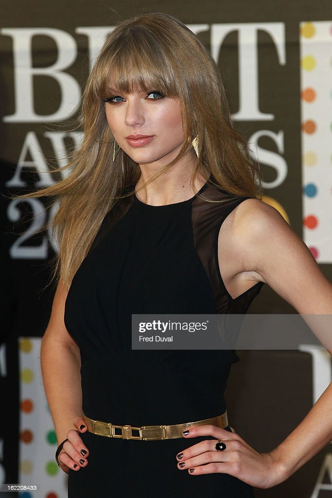 <a gi-track='captionPersonalityLinkClicked' href=/galleries/search?phrase=Taylor+Swift&family=editorial&specificpeople=619504 ng-click='$event.stopPropagation()'>Taylor Swift</a> attends the Brit Awards at 02 Arena on February 20, 2013 in London, England.