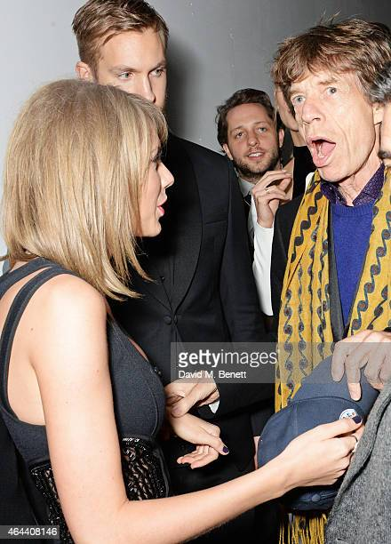 Taylor Swift Calvin Harris and Sir Mick Jagger attend the Universal Music Brits party hosted by Bacardi at The Soho House PopUp on February 25 2015...