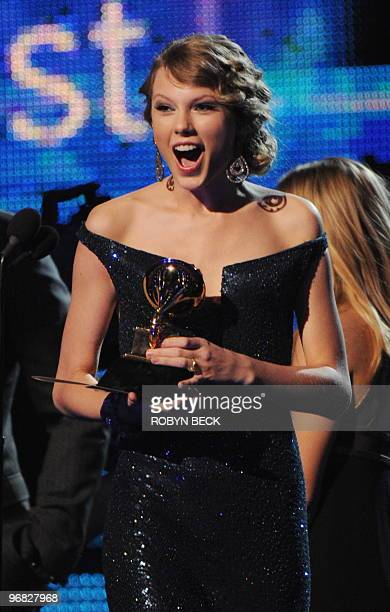 Taylor Swift celebrates after winning the Best Country Album award for Fearless at the 52nd Grammy Awards in Los Angeles on January 31 2010 AFP...