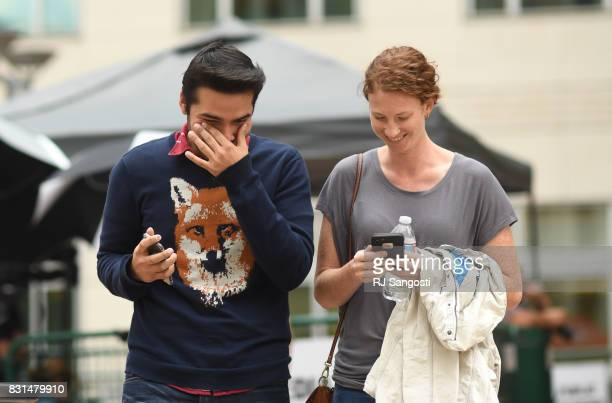 Taylor Swift fans Arturo Chacon and Jacquelyn celebrate as they leave Alfred A Arraj Courthouse during day 6 of the Taylor Swift and David Mueller...