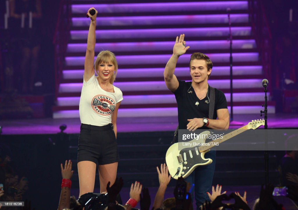 Taylor Swift is joined onstage by special guest Hunter Hayes as she wraps the North American portion of her RED tour playing to a crowd of more than 14,000 fans on the final night of three sold-out hometown shows at Nashville's Bridgestone Arena on September 21, 2013.