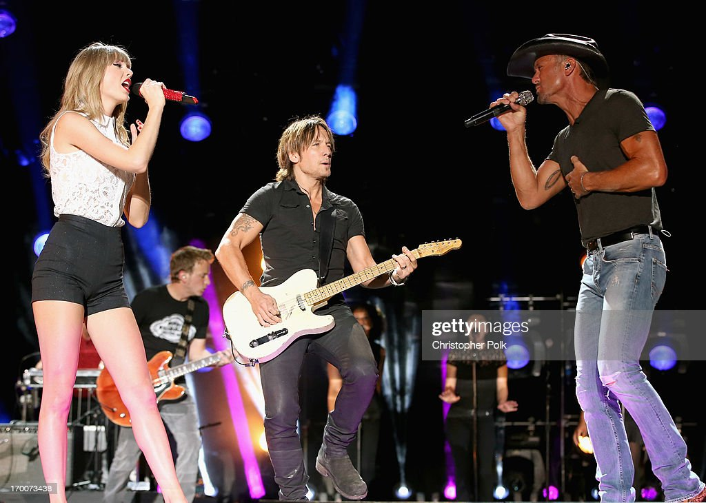 Taylor Swift, Keith Urban and Tim McGraw perform during the 2013 CMA Music Festival on June 6, 2013 in Nashville, Tennessee.