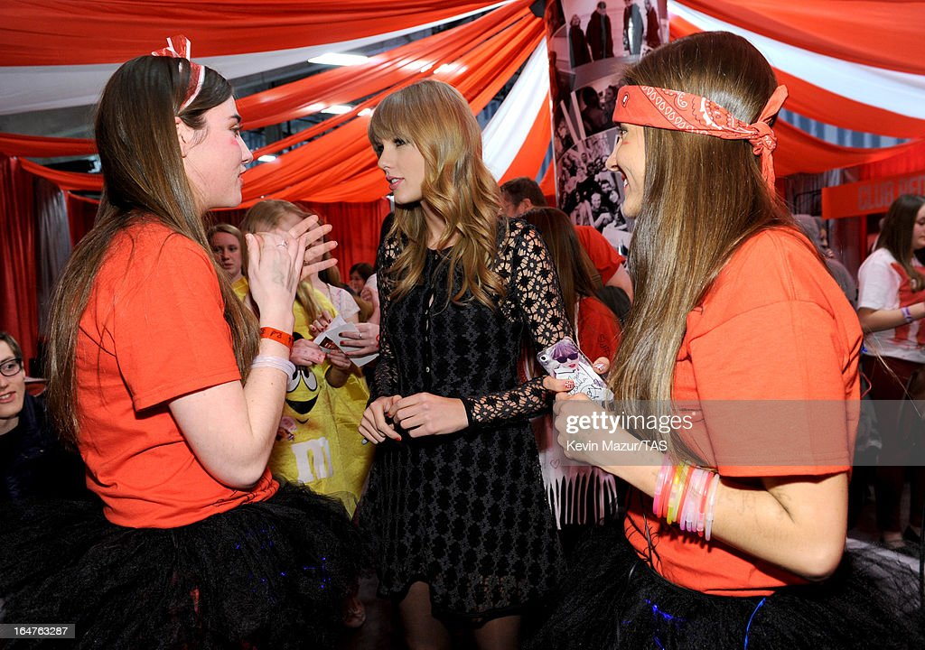 Taylor Swift meets fans in Club Red after her show at the Prudential Center on March 27, 2013 in Newark, New Jersey. Seven-time GRAMMY winner Taylor Swift plays 3 sold-out NY area shows at the Prudential Center this week on The RED Tour. Taylor plays electric guitar, banjo, piano and acoustic guitar and changes costumes 10 times over the course of the evening. The North American portion of The RED Tour will play 66 shows (including 13 stadium stops) in 47 cities in 29 states and 3 provinces spanning 6 months in 2013.