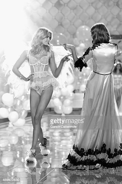 Taylor Swift performs as Victoria's Secret model Stella Maxwell walks the runway during the 2014 Victoria's Secret Fashion Show at Earl's Court...