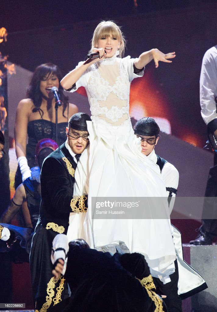 <a gi-track='captionPersonalityLinkClicked' href=/galleries/search?phrase=Taylor+Swift&family=editorial&specificpeople=619504 ng-click='$event.stopPropagation()'>Taylor Swift</a> performs during the Brit Awards 2013 at the 02 Arena on February 20, 2013 in London, England.