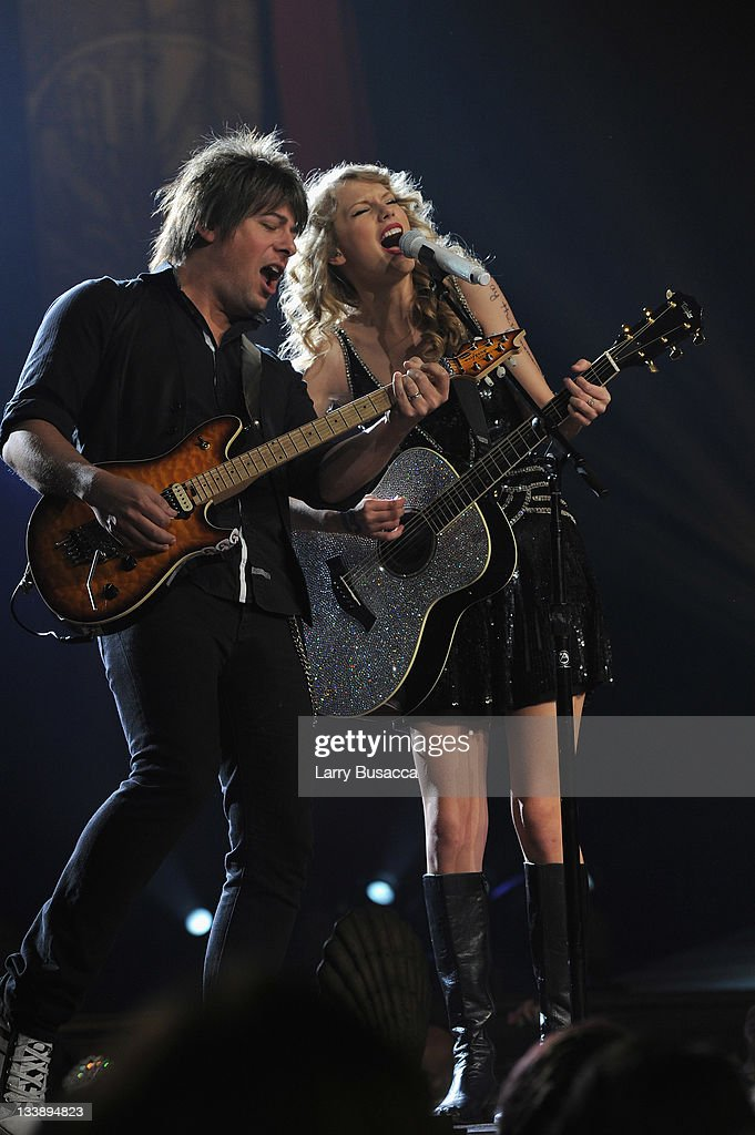 <a gi-track='captionPersonalityLinkClicked' href=/galleries/search?phrase=Taylor+Swift&family=editorial&specificpeople=619504 ng-click='$event.stopPropagation()'>Taylor Swift</a> (R) performs during the 'Speak Now World Tour' at Madison Square Garden on November 21, 2011 in New York City. <a gi-track='captionPersonalityLinkClicked' href=/galleries/search?phrase=Taylor+Swift&family=editorial&specificpeople=619504 ng-click='$event.stopPropagation()'>Taylor Swift</a> wrapped up the North American leg of her SPEAK NOW WORLD TOUR with two sold-out shows at Madison Square Garden this week. In 2011, the tour played to capacity crowds in stadiums and arenas over 98 shows in 17 countries spanning three continents, and will continue in 2012 with shows Australia and New Zealand.