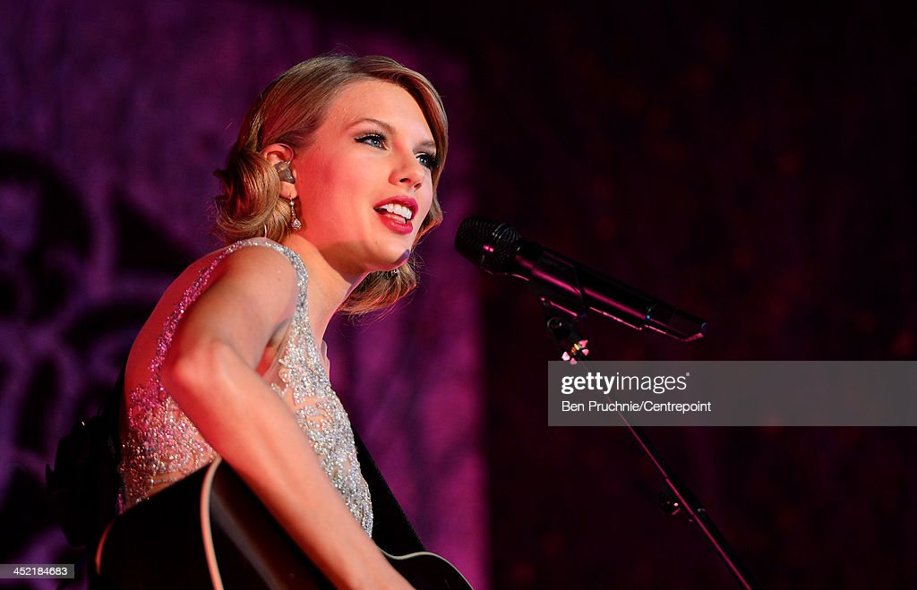 Taylor Swift performs during the Winter Whites Gala In Aid Of Centrepoint on November 26, 2013 in London, England.