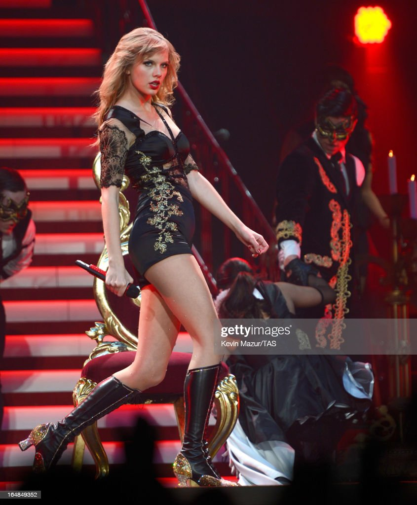 Taylor Swift performs on stage at Prudential Center on March 28, 2013 in Newark, New Jersey. Seven-time GRAMMY winner Taylor Swift plays 3 sold-out NY area shows at the Prudential Center this week on The RED Tour. Taylor plays electric guitar, banjo, piano and acoustic guitar and changes costumes 10 times over the course of the evening. The North American portion of The RED Tour will play 66 shows (including 13 stadium stops) in 47 cities in 29 states and 3 provinces spanning 6 months in 2013.