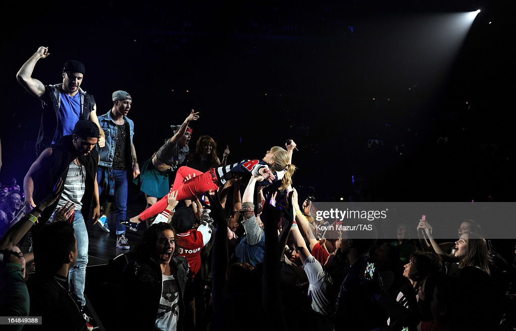 <a gi-track='captionPersonalityLinkClicked' href=/galleries/search?phrase=Taylor+Swift&family=editorial&specificpeople=619504 ng-click='$event.stopPropagation()'>Taylor Swift</a> performs on stage at Prudential Center on March 28, 2013 in Newark, New Jersey. Seven-time GRAMMY winner <a gi-track='captionPersonalityLinkClicked' href=/galleries/search?phrase=Taylor+Swift&family=editorial&specificpeople=619504 ng-click='$event.stopPropagation()'>Taylor Swift</a> plays 3 sold-out NY area shows at the Prudential Center this week on The RED Tour. Taylor plays electric guitar, banjo, piano and acoustic guitar and changes costumes 10 times over the course of the evening. The North American portion of The RED Tour will play 66 shows (including 13 stadium stops) in 47 cities in 29 states and 3 provinces spanning 6 months in 2013.